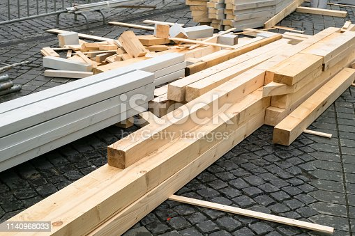 istock wooden beams stacked for construction 1140968033