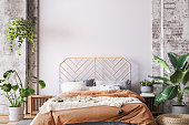 istock Wooden bed in loft apartment design, interior of bedroom with empty wall mockup 1309054558