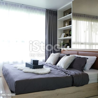 istock Wooden bed in room. 682163194