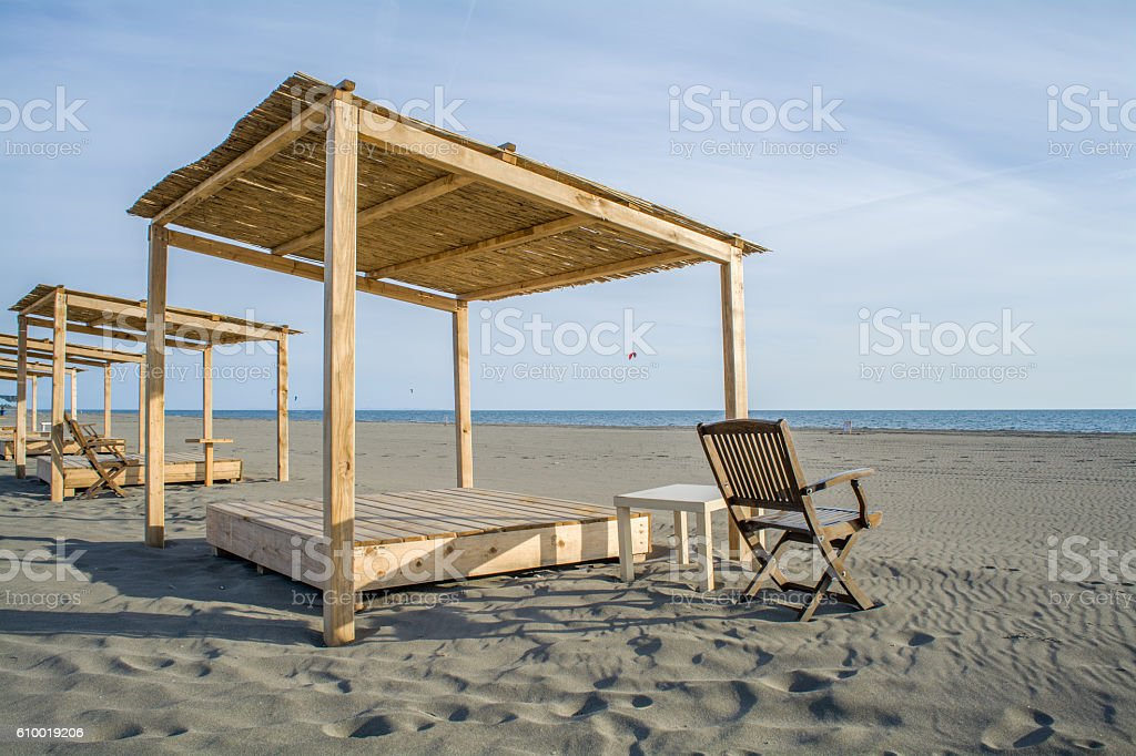 Wooden beds on the beach​​​ foto