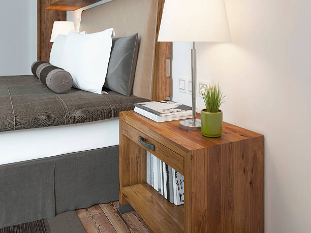 Wooden bedside table with a niche for the decor.