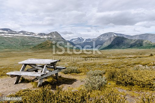 istock Wooden bench along the road in Jotunheimen national park in Norway 1338405410