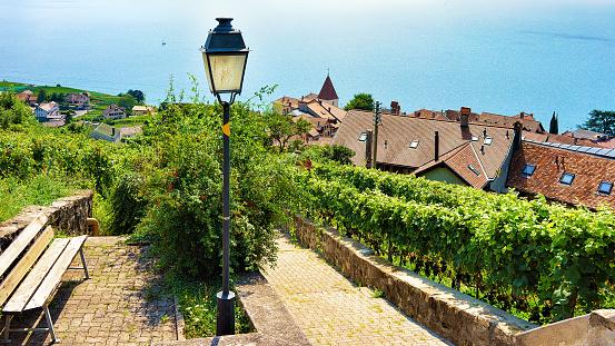 Wooden bench and lantern on Lavaux Vineyard Terraces trail Switzerland