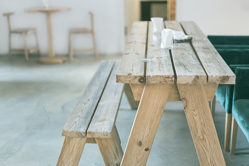 593305530 istock photo Wooden bench and table indoor 914669258