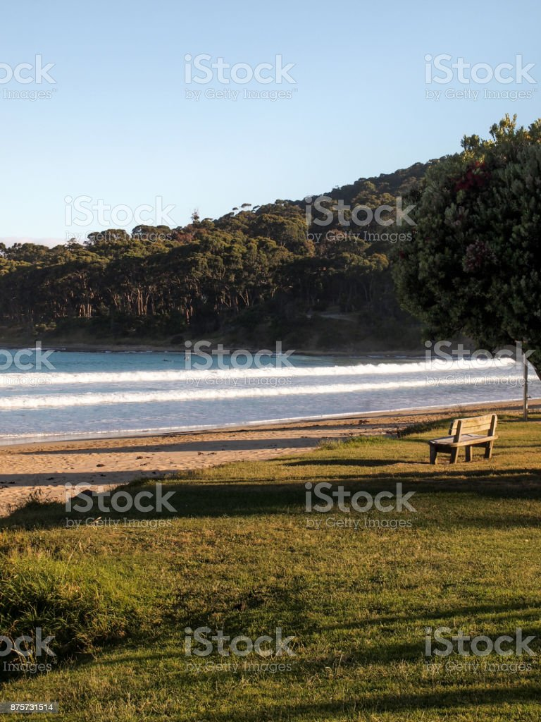 Wooden Bench at the Sea stock photo