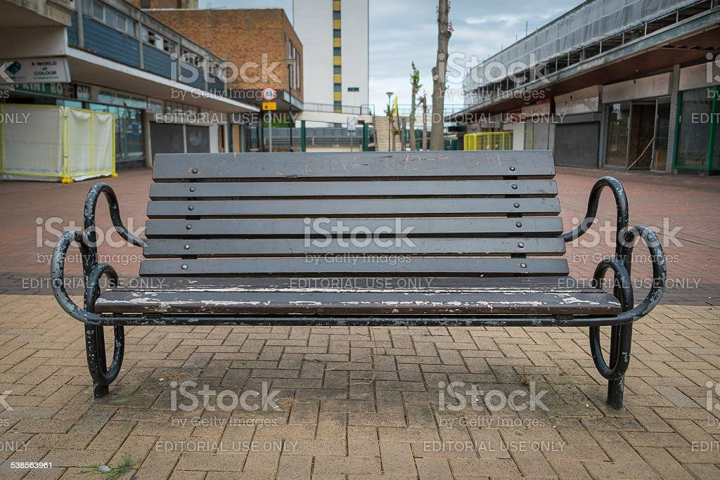 Wooden bench in an abandoned high street stock photo