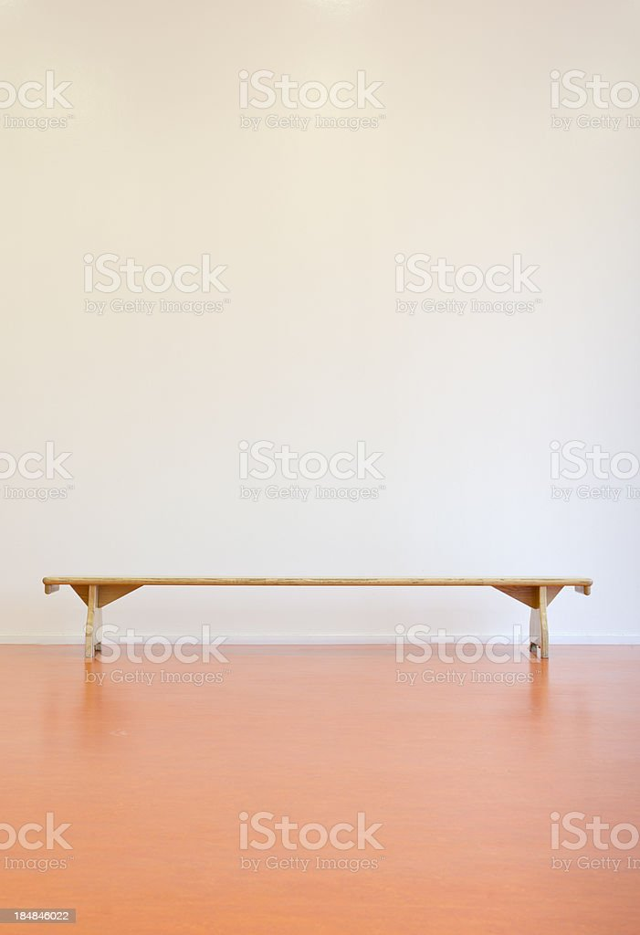 Wooden bench in front of a wall royalty-free stock photo
