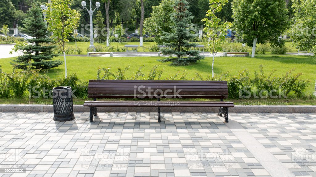 Wooden bench in the city park stock photo