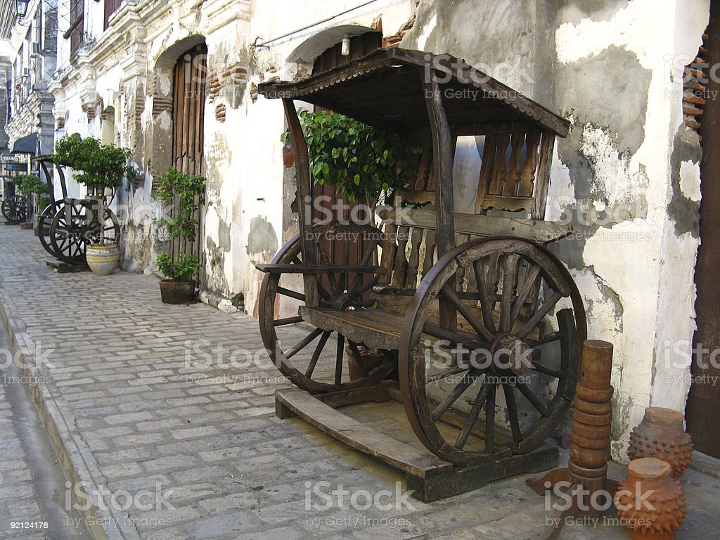 A wooden bench made from an old wagon royalty-free stock photo