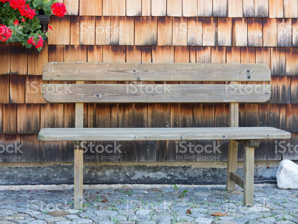 Enjoyable Wooden Bench On Cobblestone Pavement Against Wooden Wall Onthecornerstone Fun Painted Chair Ideas Images Onthecornerstoneorg