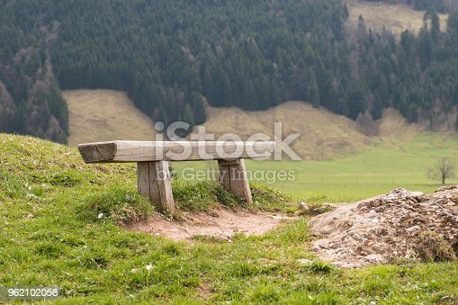 Wooden bench on Rigi mountain, Switzerland. Old wooden bench in nature. Outdoor place to rest. Swiss Alps.