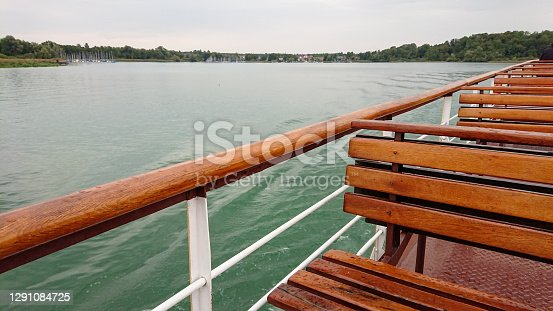 istock Wooden bench seats on ship on Lake Chiemsee in Bavaria, Germany 1291084725