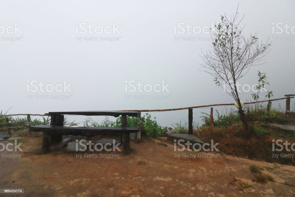 Wooden bench with heavy fog on the sky. royalty-free stock photo
