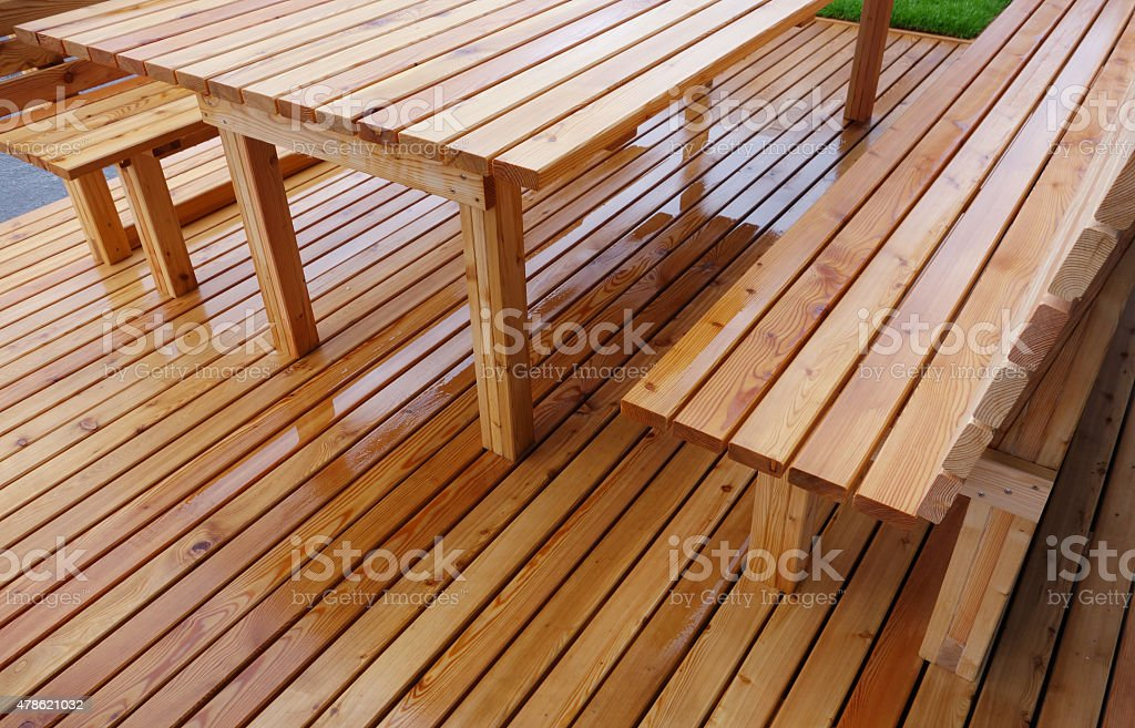 Wooden benches and table outdoor stock photo