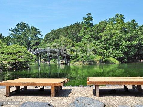 istock wooden benches and wooden bridge in Japanese garden. 622076308