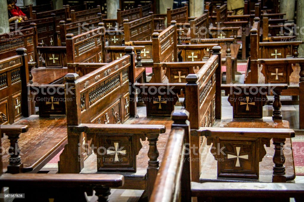 Wooden benches decorated by crosses in the Hanging Church in Coptic Cairo, Egypt stock photo