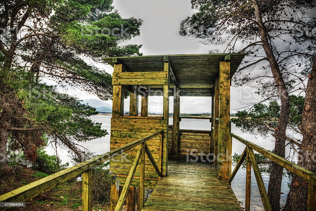 wooden bird watching cabin in hdr stock photo
