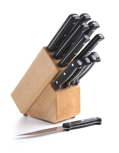 A wooden block and knife set on a white background stock photo