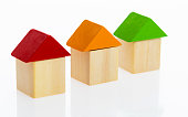 Wooden block houses on white background