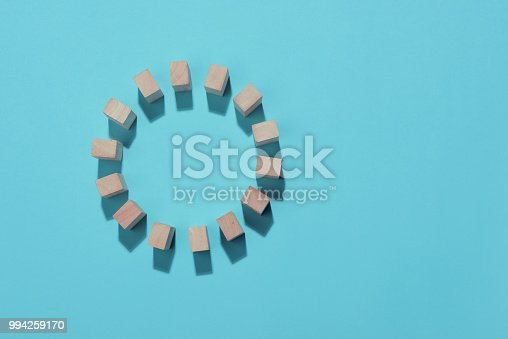 Wooden block in circle on blue background.