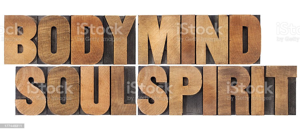 Wooden block letters spelling body, mind, soul, and spirit royalty-free stock photo
