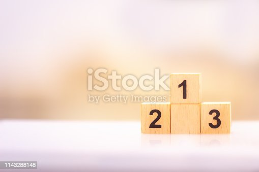 istock wooden block number one two three using as business and property concept. 1143288148