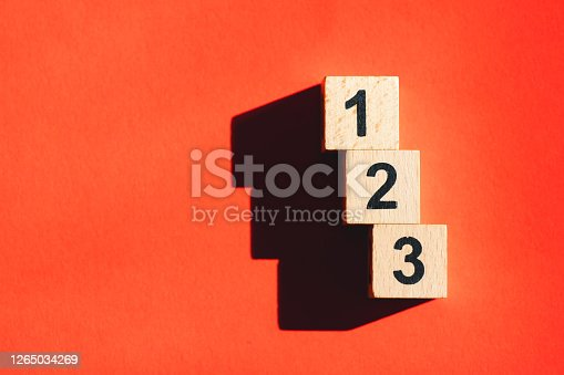 Wooden block number using as business and financial concept - Orange background