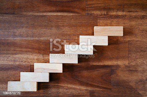 istock Wooden block stacking as step staircase. Business concept for growth successful. Blank for copy text 1064570770