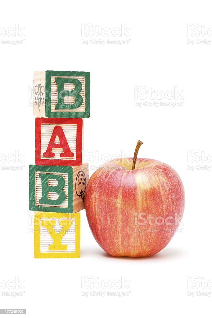 Wooden blocks and apple with baby royalty-free stock photo