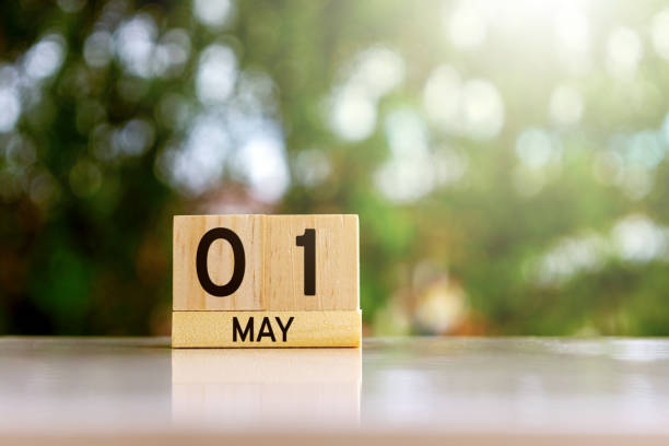 wooden blocks calendar with date 01 may labor day - labor day stock pictures, royalty-free photos & images
