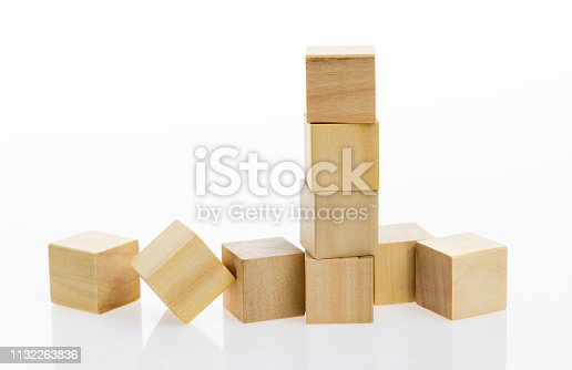1134528355 istock photo Wooden blocks on white background 1132263836
