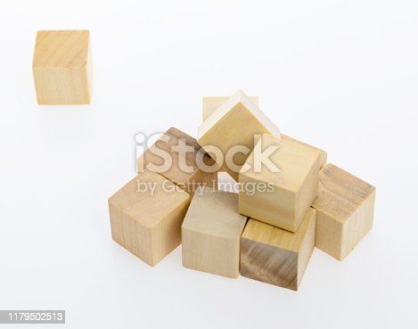 1134528355 istock photo Wooden blocks on white background 1179502513