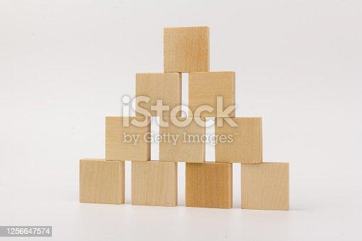 wooden children's designer, constructor blocks, building sets piramid on white bachground, isolated
