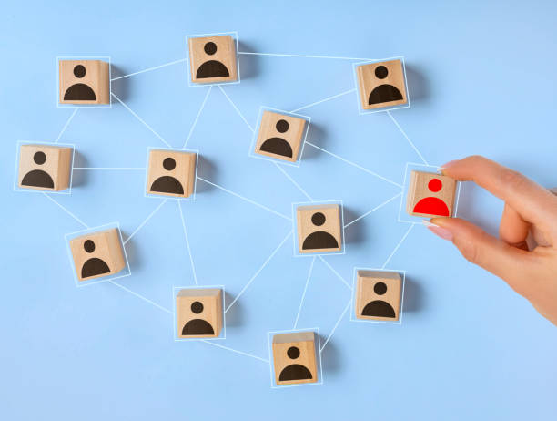 Wooden blocks with people icon on blue background stock photo