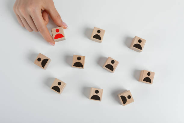 Wooden blocks with people icons stock photo