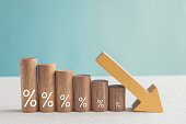 istock Wooden blocks with percentage sign and down arrow, financial recession crisis, interest rate decline, risk management concept 1227064262