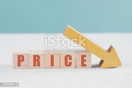 Wooden blocks with PRICE word and yellow down arrow, impacts of Covid-19 disruption, global economy financial crisis business concept