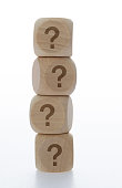 Wooden blocks with question mark.