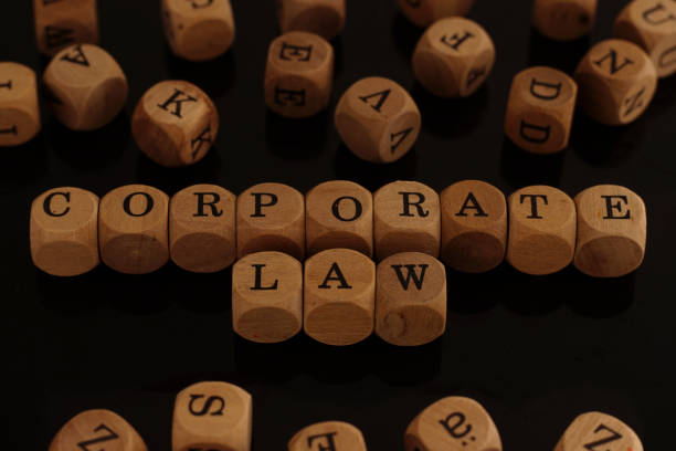 Wooden blocks with the word Corporate Law stock photo