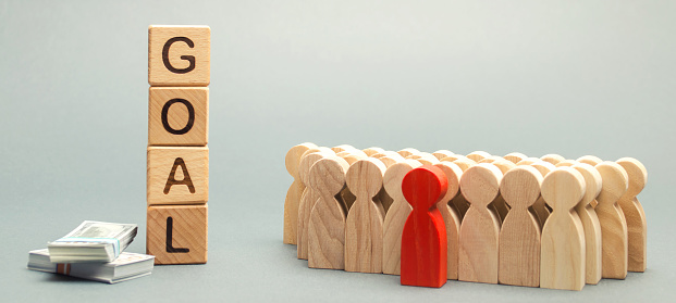 465048456 istock photo Wooden blocks with the word Goal, money and business team. Business concept. Cooperation and teamwork. Improving the efficiency of the company's sales. Achieving financial targets. Increase profits 1133135228