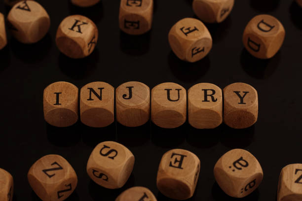 Wooden blocks with the word Injury stock photo