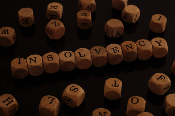 Wooden blocks with the word Insolvency stock photo