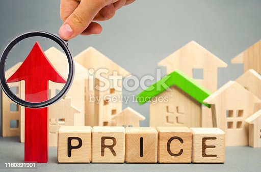 istock Wooden blocks with the word Price, up arrow and wooden houses. The increase in housing prices. Rising rent for an apartment. The growth of utilities. High house value. Real estate market 1160391901