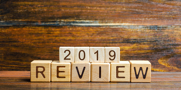istock Wooden blocks with the word Review 2019. Business concept. Feedback, Progress. New trends and prospects. Financial performance indicator. Results of the year. Financial and economic activities. Audit. 1162936528