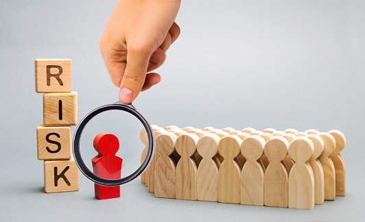 1163501702 istock photo Wooden blocks with the word Risk and a team with a leader. Business concept of teamwork, crisis solution and problem management. Business planning. Investment in the project. Risk assessment. Forecast 1152830705