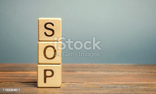 istock Wooden blocks with the word SOP ( Standard operating procedure ). Instructions to assist employees in complex routine operations. Business concept 1193064611