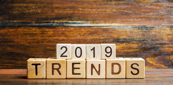 1163501702 istock photo Wooden blocks with the word Trends 2019. Main trend of changing something. Popular and relevant topics. New ideological trends of fashion. Recent and latest trend. Evaluation methods. Fashionable 1161372993