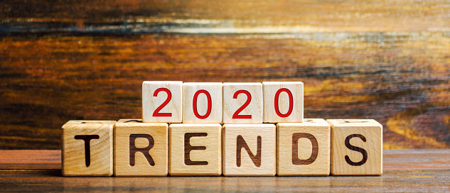 1163501702 istock photo Wooden blocks with the word Trends 2020. Main trend of changing something. Popular and relevant topics. New ideological trends of fashion. Recent and latest trend. Evaluation methods. Fashionable 1162994852
