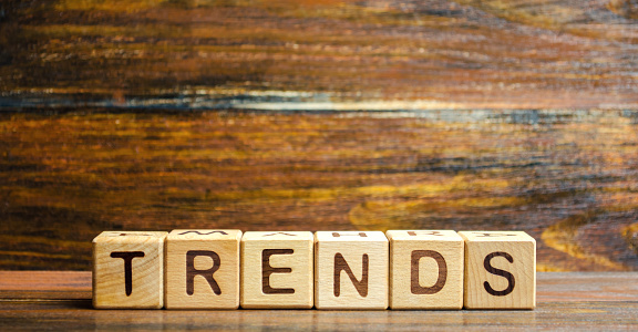 1163501702 istock photo Wooden blocks with the word Trends. Main trend of changing something. Popular and relevant topics. New ideological trends of fashion. Recent and latest trend. Evaluation methods. Fashionable 1158389254