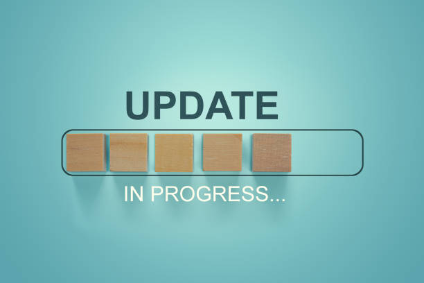 Wooden blocks with the word UPDATE  in loading bar progress. Wooden blocks with the word UPDATE  in loading bar progress. software update stock pictures, royalty-free photos & images